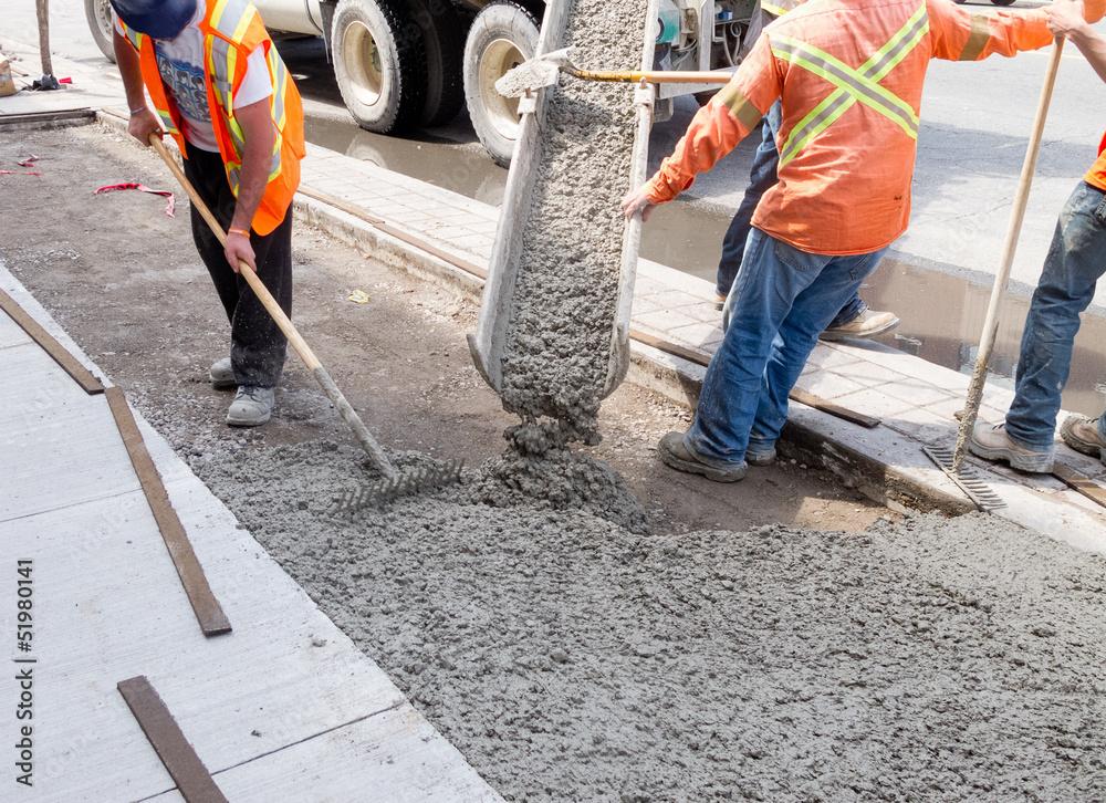 Fototapeta Roadworks - pouring cement