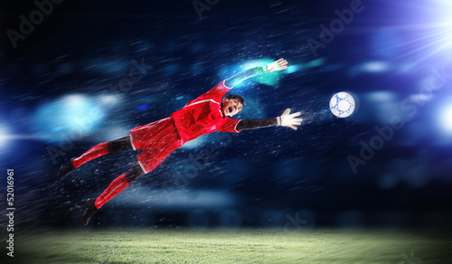 Photo Stands Football Goalkeeper catches the ball