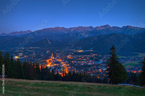 Night panorama of Zakopane against the Tatras, Poland.