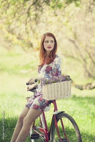 Girl on a bike in the countryside - 52104395