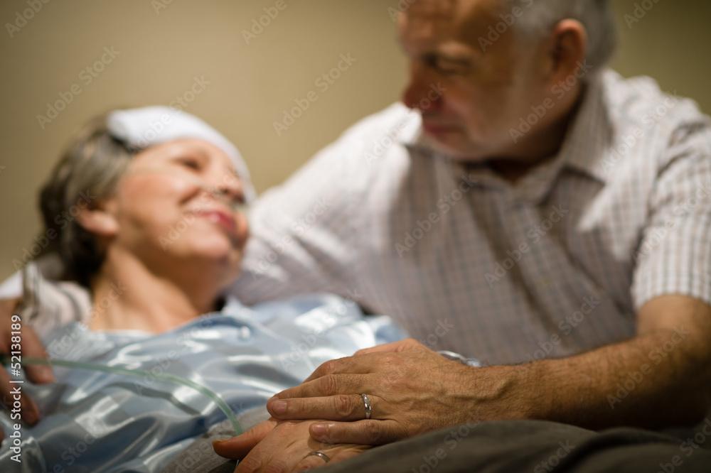 Fototapeta Old woman in pain lying bed