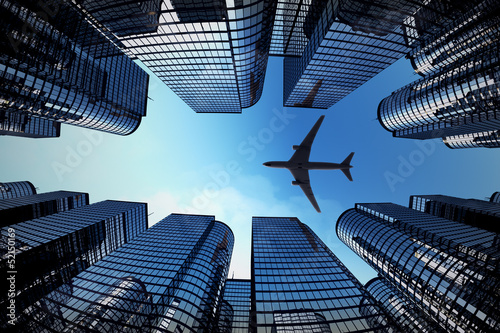 Spoed Foto op Canvas Aan het plafond Business towers with a airplane silhouette