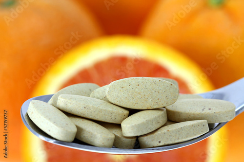 Film Coated Tablets of Vitamin C on the Orange background Wallpaper Mural