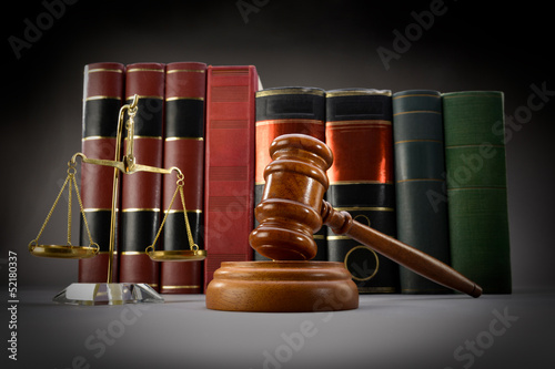 Plakat na zamówienie Scales of justice, law books and gavel over dark background