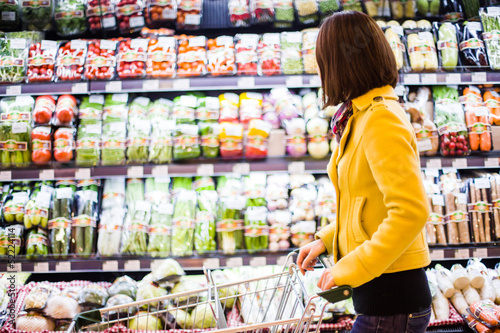 Young woman shopping in the supermarket Canvas Print