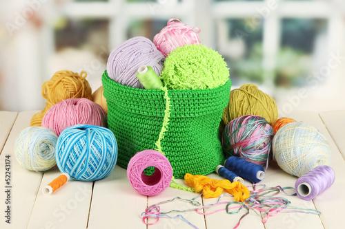Fotografie, Obraz  Colorful yarn for knitting in green basket