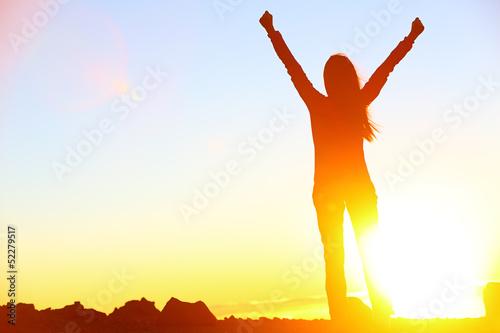 Fotografia  Happy celebrating winning success woman sunset