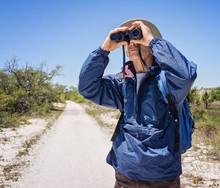 Man Hiking And Birdwatching, L...