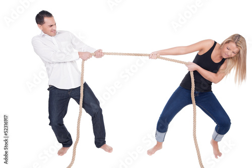 Fotografie, Obraz  Man and woman having a tug of war