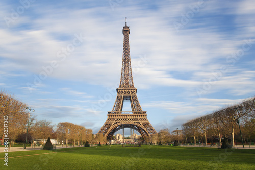 Poster Paris Eiffel tower with moving clouds on blue sky, Paris