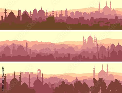 Cuadros en Lienzo Horizontal banners of big arab city at sunset.