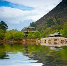 Chinese Pagoda Reflecting In The Lake
