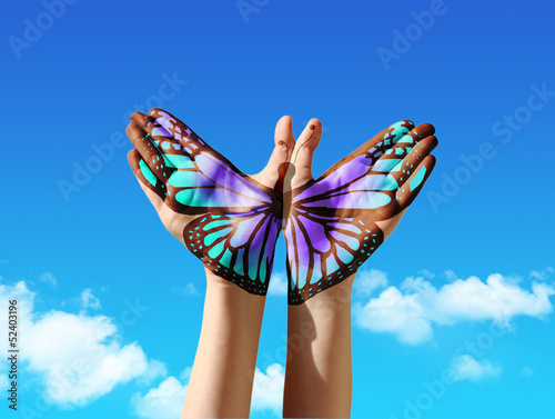 Foto op Plexiglas Vlinder Hand and butterfly hand painting, tattoo, over a blue sky