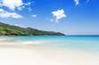 White coral beach sand and azure ocean. Seychelles islands.