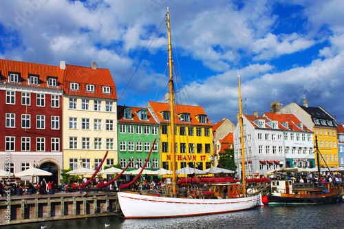 Nyhavn is old waterfront and canal district in Copenhagen. Poster