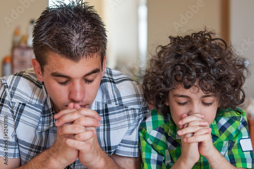 Fotografie, Obraz  Brothers praying at home