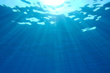 Sunbeams penetrating blue ocean background