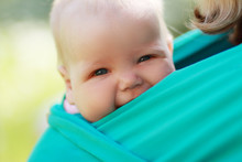 Baby Closed To Mom In Sling