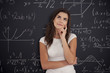 Female student thinking about mathematics problem