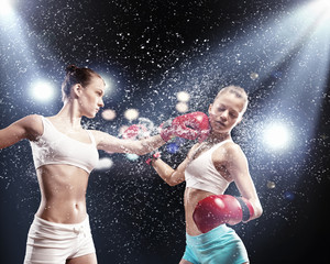 Fototapeta Boks Two pretty women boxing
