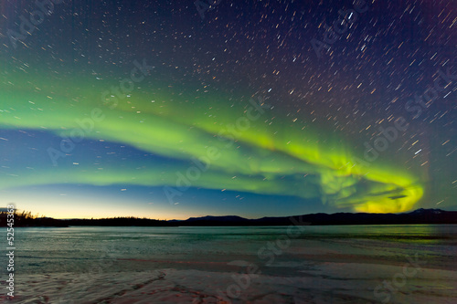 Canvas Prints Northern lights Northern Lights and morning dawn over frozen lake