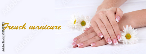 Staande foto Manicure Woman hands with french manicure and flowers