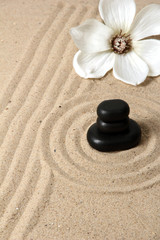 Fototapeta Zen garden with raked sand and round stones close up