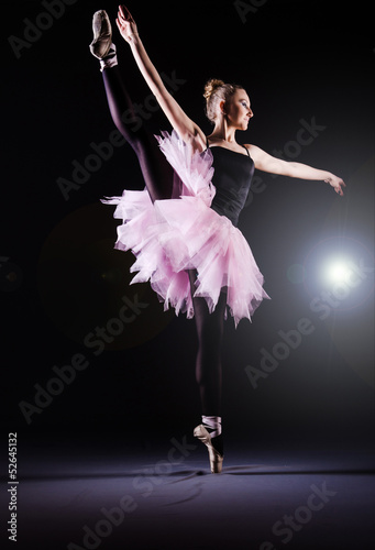 Ballerina dancing in the dark studio - 52645132