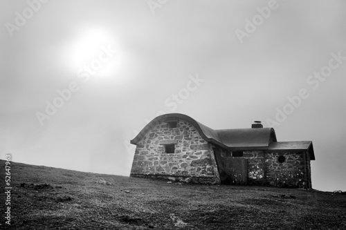Shelter in mountain in the morning with fog and sun