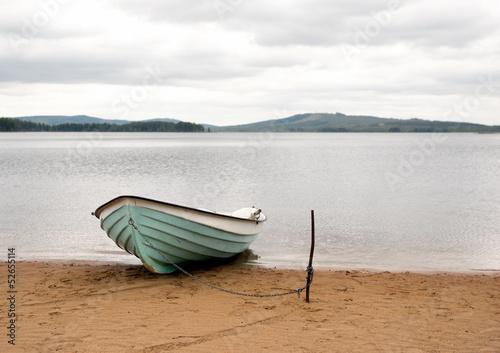 Photo Boat on sandy beach