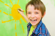 Boy draws the sun