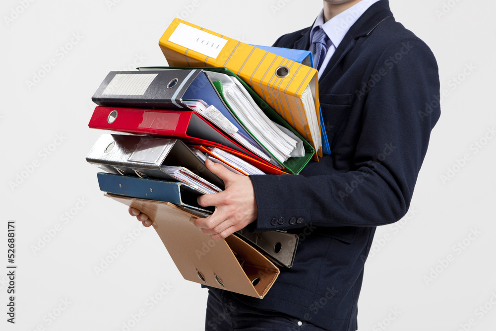 Fototapeta Business man carrying folders