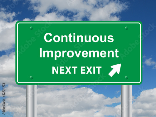 Fotografía  CONTINUOUS IMPROVEMENT NEXT EXIT Sign (efficiency quality lean)