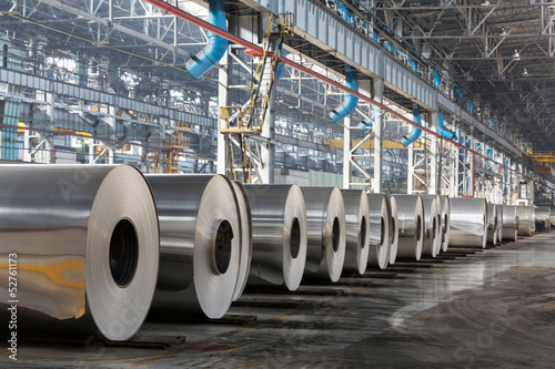 Fotografie, Obraz  Row of rolls of aluminum lie in production shop of plant.