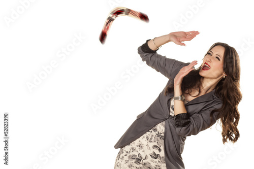 woman defending herself with her hands from the boomerang Wallpaper Mural