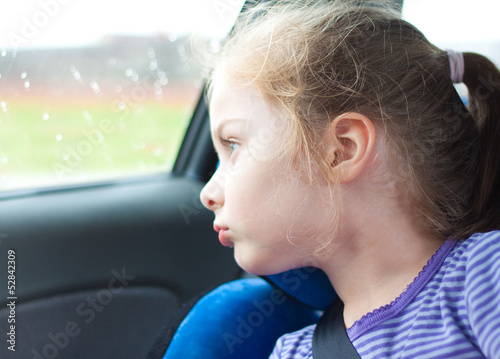 Five Years Old Child Girl Traveling In A Car Seat