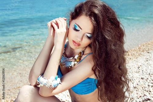 Healthy Long Hair. Beautiful girl on the beach posing near sea w Plakát