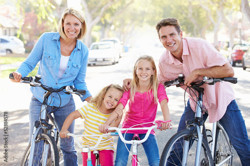 Photo Stands Cycling Family Cycling On Suburban Street