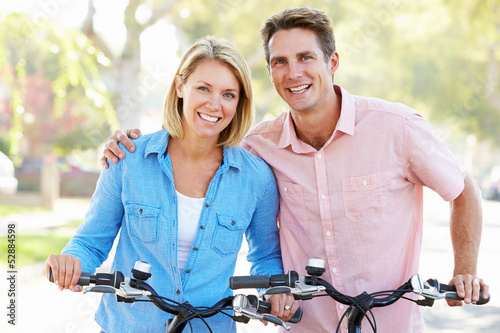 Photo Stands Cycling Couple Cycling On Suburban Street