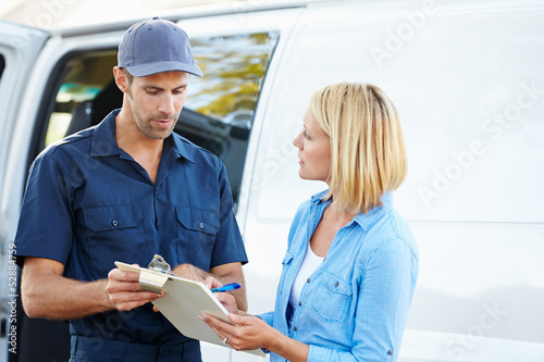 Fotografie, Obraz  Customer Signing For Delivery From Courier
