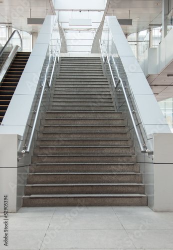 Foto op Plexiglas Trappen Stairway with handrails leading to upstair.