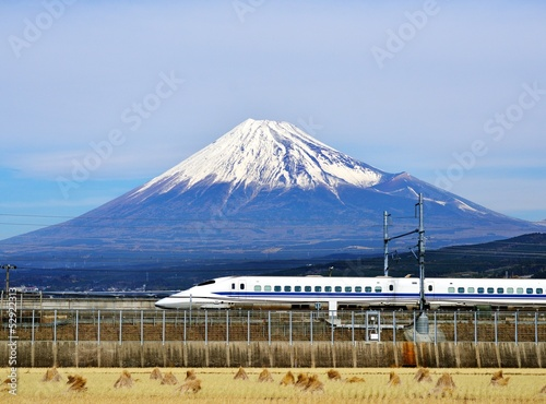 Photo Stands Blue sky Mt. Fuji and the Bullet Train