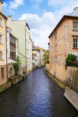 Fototapeta na wymiar Prague River Street home