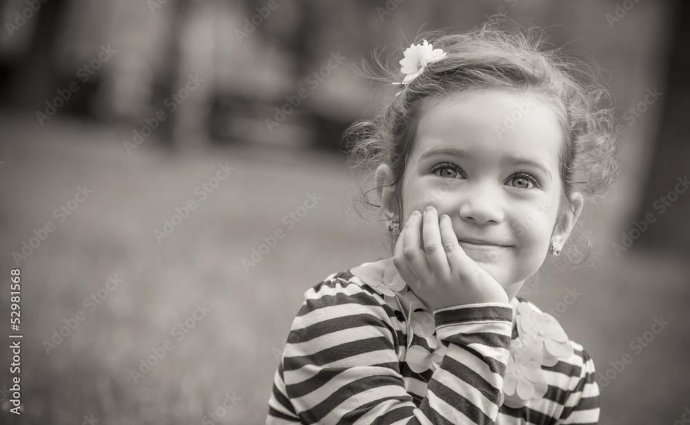 Fototapeta Black and white portrait of cute little girl in a park