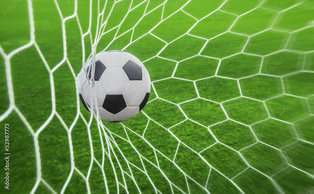 Fototapeta soccer ball in goal