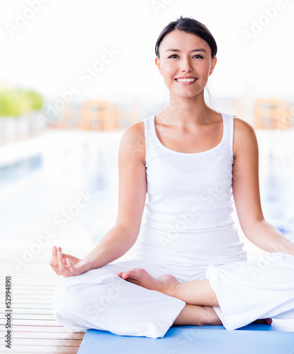 Woman practicing yoga - 52994890