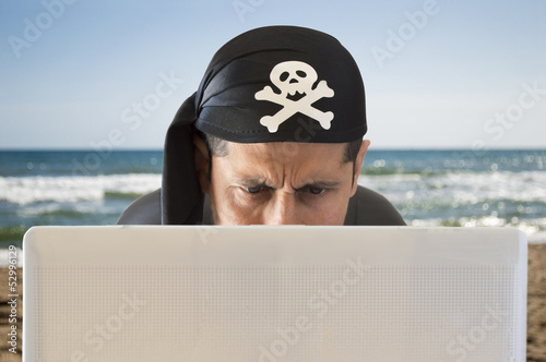 Fotografering  hacker  looking confused on the beach