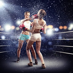 Fototapeta Boks Two women boxing in ring