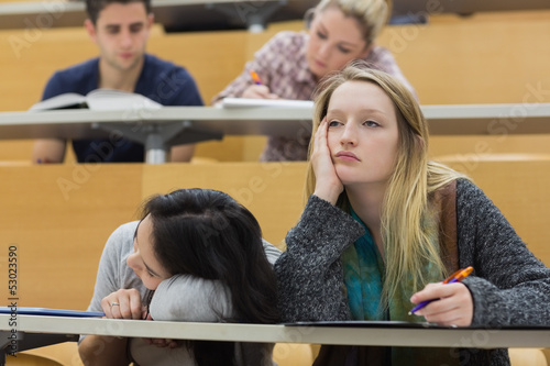 Fotografie, Obraz  Demotivated students in a lecture hall