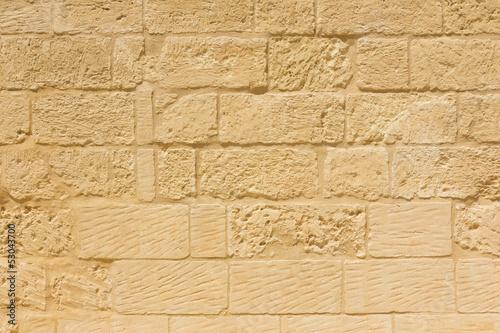 Photo  Weathered sandstone brick wall
